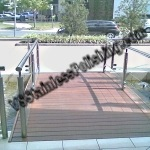 Our mobile polishing service Polished stainless steel handrailings on entree bridge in front of a building.