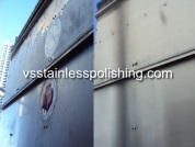 Polishing stainless steel rooftop airconditioner.